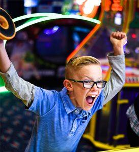Boondocks - Excited Boy Playing Air Hockey